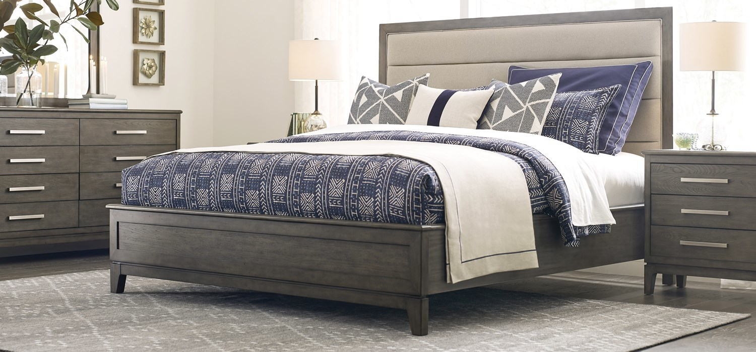 Modern, solid wood bedroom collection featuring an upholstered headboard.
